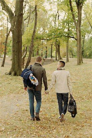 Gay couple walking in park Stock Photo - Premium Royalty-Free, Code: 614-07239945