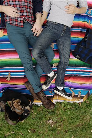 Gay couple on rainbow blanket Stock Photo - Premium Royalty-Free, Code: 614-07239942