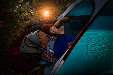 Mature couple lying together in tent Stock Photo - Premium Royalty-Free, Code: 614-07239968