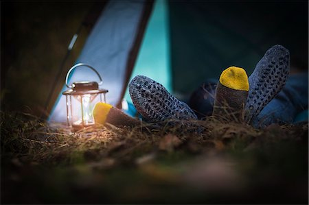 Couple lying in tent -  feet together Stock Photo - Premium Royalty-Free, Code: 614-07239972