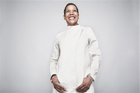 Studio portrait of mature woman with hand in pockets Stock Photo - Premium Royalty-Free, Code: 614-07240016