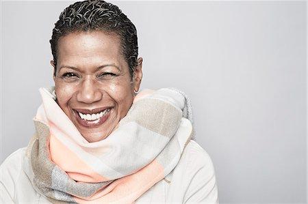 Studio portrait of happy mature woman Stock Photo - Premium Royalty-Free, Code: 614-07240013