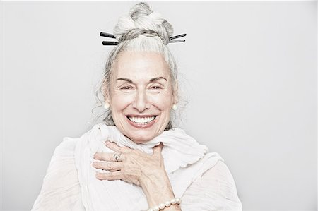 Studio portrait of sophisticated senior woman laughing Stock Photo - Premium Royalty-Free, Code: 614-07240021