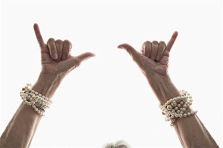 Studio shot of mature woman's gesturing hands Stock Photo - Premium Royalty-Free, Code: 614-07240047