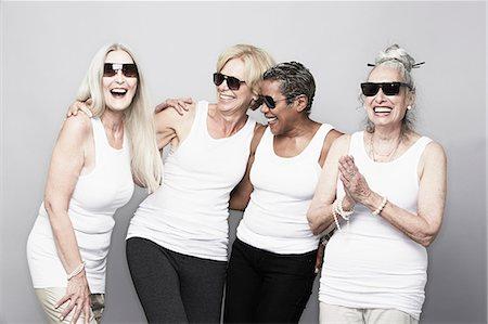 Studio portrait of senior women friends in sunglasses Stock Photo - Premium Royalty-Free, Code: 614-07240040