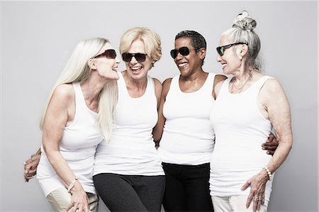 Studio portrait of senior women friends having fun Stock Photo - Premium Royalty-Free, Code: 614-07240041