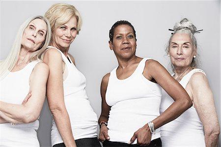 Studio portrait of senior women friends posing for camera Stock Photo - Premium Royalty-Free, Code: 614-07240042
