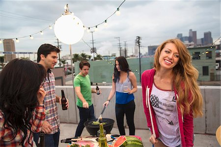Young adult friends enjoying barbeque Stock Photo - Premium Royalty-Free, Code: 614-07240194