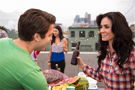 flirting - Young couple flirting at barbeque Stock Photo - Premium Royalty-Free, Code: 614-07240193