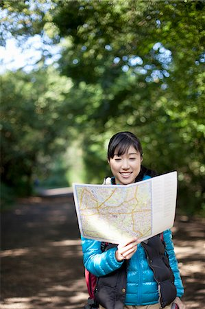 Young female hiker looking at map Stock Photo - Premium Royalty-Free, Code: 614-07444008
