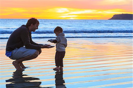 Father and toddler son playing on beach, San Diego, California, USA Stock Photo - Premium Royalty-Free, Code: 614-07444036