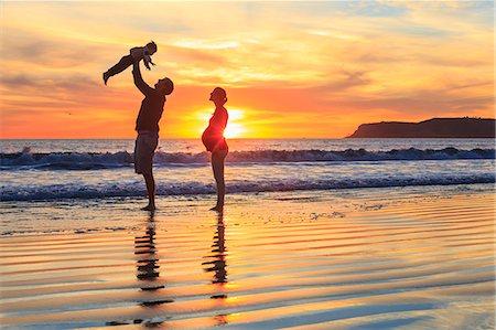 family active beach - Family with toddler son playing on beach, San Diego, California, USA Stock Photo - Premium Royalty-Free, Code: 614-07444037