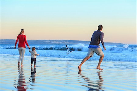 family active beach - Family and toddler son playing on beach, San Diego, California, USA Stock Photo - Premium Royalty-Free, Code: 614-07444039