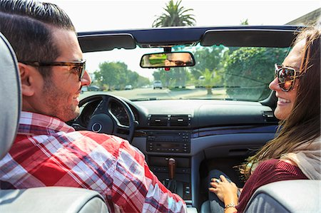 Young couple in convertible, San Diego, California, USA Stock Photo - Premium Royalty-Free, Code: 614-07444032
