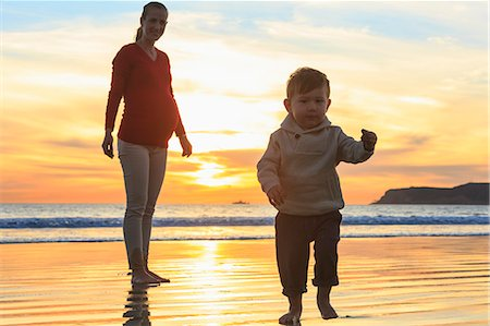 family active beach - Mother and toddler son playing on beach, San Diego, California, USA Stock Photo - Premium Royalty-Free, Code: 614-07444040