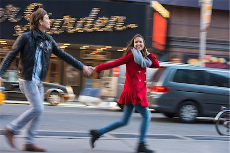 Young couple running along street, New York City, USA Stock Photo - Premium Royalty-Free, Code: 614-07444089