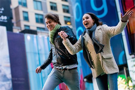 Young couple running on street, New York City, USA Stock Photo - Premium Royalty-Free, Code: 614-07444083