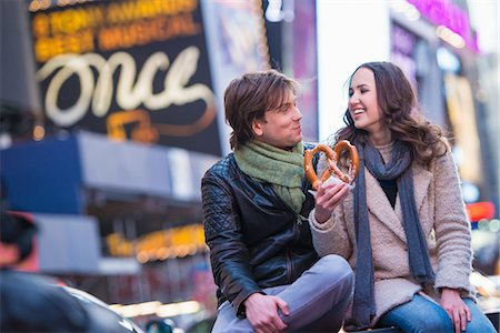 Young couple sharing pretzel, New York City, USA Stock Photo - Premium Royalty-Free, Code: 614-07444091
