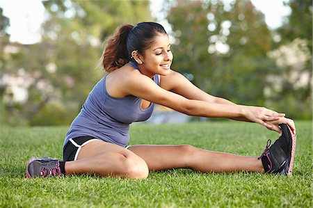 stretch - Young woman doing stretching exercise Stock Photo - Premium Royalty-Free, Code: 614-07444100