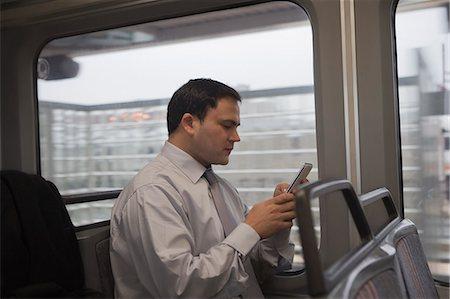 Businessman commuting to work Stock Photo - Premium Royalty-Free, Code: 614-07444179