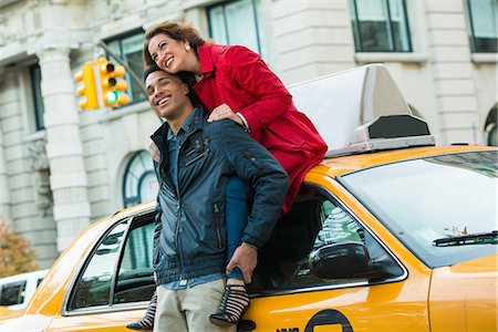 Young tourist couple with yellow cab, New York City, USA Stock Photo - Premium Royalty-Free, Code: 614-07444171