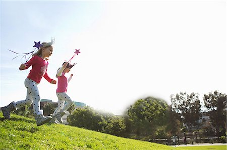 dress up girl - Two young sisters dressed up as fairies running down hill Stock Photo - Premium Royalty-Free, Code: 614-07444184
