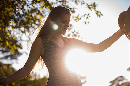 femininity - Teenage girl dancing in park Stock Photo - Premium Royalty-Free, Code: 614-07444331