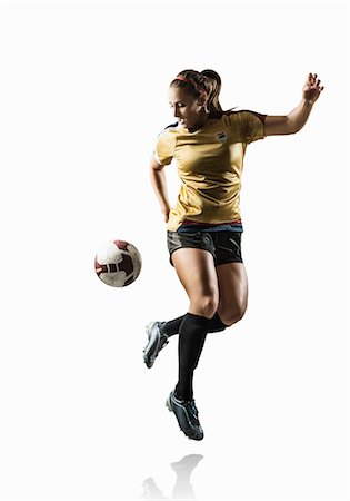 footballeur - Studio shot of young female soccer player back kicking ball Stock Photo - Premium Royalty-Free, Code: 614-07444387