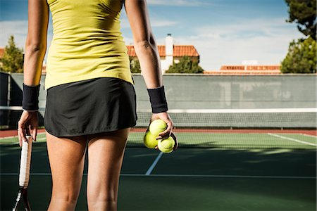 Female tennis player holding balls Stock Photo - Premium Royalty-Free, Code: 614-07443919