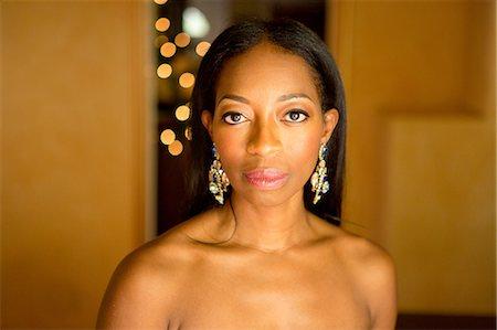 Portrait of mature woman wearing earrings Stock Photo - Premium Royalty-Free, Code: 614-07443927