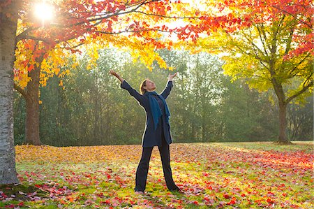 stretching (people exercising) - Woman stretching in forest Stock Photo - Premium Royalty-Free, Code: 614-07443932