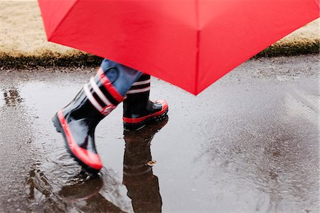people with umbrellas in the rain - Wellingtons and umbrella Stock Photo - Premium Royalty-Free, Code: 614-07443943