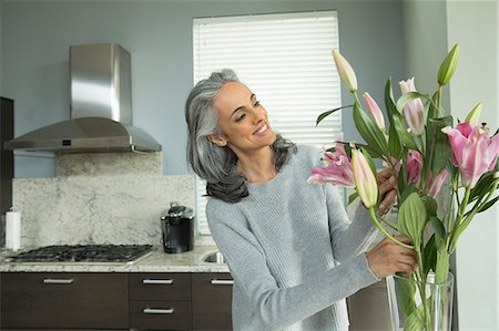 Woman arranging lilies Stock Photo - Premium Royalty-Free, Code: 614-07453264