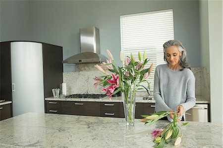 Woman arranging lilies Stock Photo - Premium Royalty-Free, Code: 614-07453265