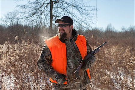 Mid adult male hunter in Petersburg State Game Area, Michigan, USA Stock Photo - Premium Royalty-Free, Code: 614-07453426