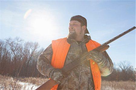Mid adult man holding shotgun in Petersburg State Game Area, Michigan, USA Stock Photo - Premium Royalty-Free, Code: 614-07453428