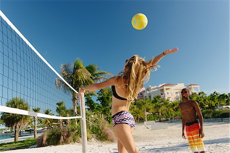 Young adult friends playing beach volleyball, Providenciales, Turks and Caicos Islands, Caribbean Stock Photo - Premium Royalty-Free, Code: 614-07453421