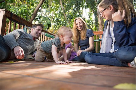 five - Family relaxing on porch Stock Photo - Premium Royalty-Free, Code: 614-07486927