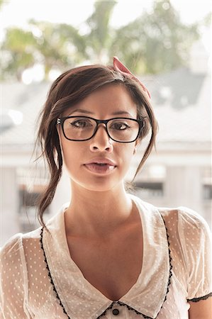 femininity - Portrait of young woman wearing spectacles Stock Photo - Premium Royalty-Free, Code: 614-07487021