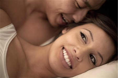 Close up of couple lying in bed Stock Photo - Premium Royalty-Free, Code: 614-07487037