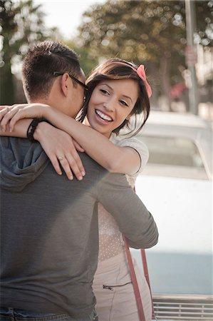 Happy couple hugging on the street Stock Photo - Premium Royalty-Free, Code: 614-07487031