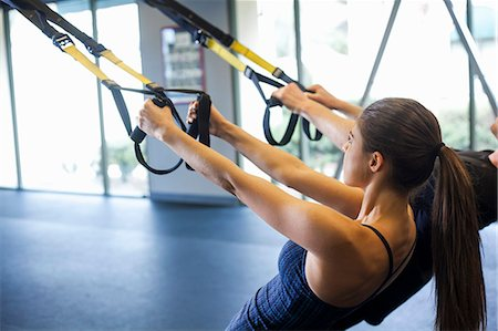 pulling - Couple working out in gym Stock Photo - Premium Royalty-Free, Code: 614-07487098