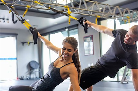 Couple working out in gym Stock Photo - Premium Royalty-Free, Code: 614-07487099