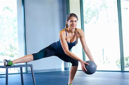 Young woman working out with medicine ball Stock Photo - Premium Royalty-Free, Code: 614-07487105