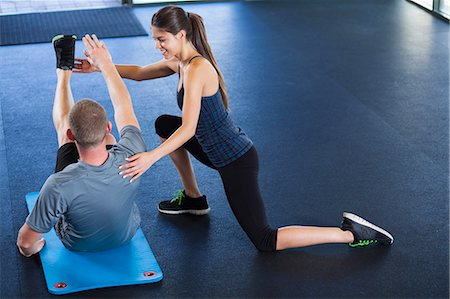 Couple helping each other in gym Stock Photo - Premium Royalty-Free, Code: 614-07487106