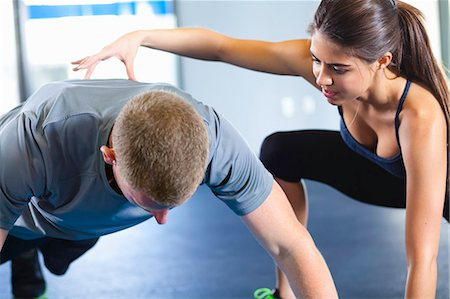 Couple helping each other in gym Stock Photo - Premium Royalty-Free, Code: 614-07487107