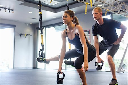Couple working out with weights Stock Photo - Premium Royalty-Free, Code: 614-07487101