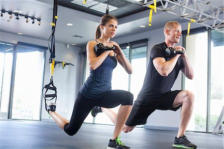 Couple working out with weights Stock Photo - Premium Royalty-Free, Code: 614-07487102