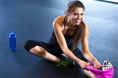 physical fitness - Young woman stretching Stock Photo - Premium Royalty-Free, Code: 614-07487111