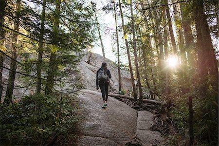 Young woman walking through forest, Squamish, British Columbia, Canada Stock Photo - Premium Royalty-Free, Code: 614-07487135